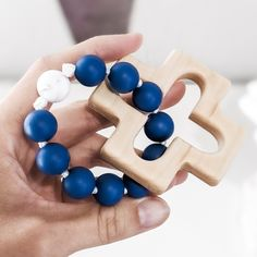 This rosary ring was handmade and the recipient was prayed for during its construction. The silicone bead decade ring makes a perfect Baptism gift for a baby boy. The wooden cross is made by a local Catholic artisan. It is cut from durable maple wood, sanded smooth, and finished with a baby safe and food grade mineral oil/beeswax blend. The beads used are FDA approved food grade silicone. Learn more about the bead safety. This item has been third party tested and meets the safety requirements se Catholic Baptism Gifts, Baby Boy Baptism Gifts, Rosary Catholic, First Communion Gifts, Baptism Favors, Blue Rings, Art For Sale, Rosaries, Baby Safe