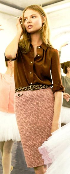 Peach tweed skirt, leopard print belt and brown silk blouse.