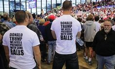 Supporters wearing Trump T-shirts listen to Republican presidential nominee Donald Trump.