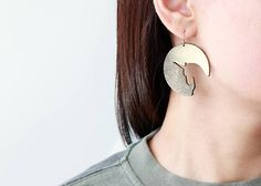 These bold and edgy everyday earrings are sure to get you noticed everywhere, laser cut out unicorn silhouette from a reclaimed quality black genuine cowhide, airbrushed in metallic gold and fixed with a shiny protective coat. ♦ These gorgeous drops are lightweight and comfy to wear all day, perfect to dress up or dress down with any outfit. They make a fab gift for everyone in love with unicorns and galaxy  • Approx drop length measures 2 inches (8.5 cm) from top of the earring • Approx…