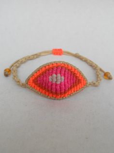 Evil eye neon ombre macrame braceletThe all by LuckyRatJewellery, €10.00