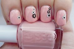 light pink nails with black and white flower decals. CUTE!