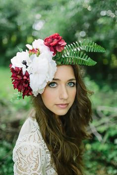 Make your own floral crown with silk flowers from Afloral.com.  Find hihg-quality silk flowers in rich jeweltones and pastels for your DIY boho chic wedding.