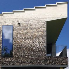 simple balcony rail doesn't detract from the beauty of the flint Roof Lines, Balcony Railing, Grand Staircase, Concrete Blocks, Art Of Living, Cladding, Architecture Details, Brick, Exterior