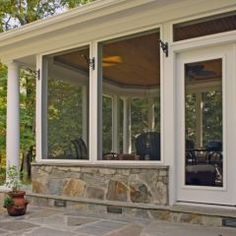screened porch with paver patio