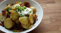 Loaded Spuds:    Fingerling potatoes with crème fraîche, bacon and chives.     http://www.tastingtable.com