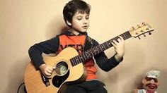 Afbeeldingsresultaat voor boy playing guitar