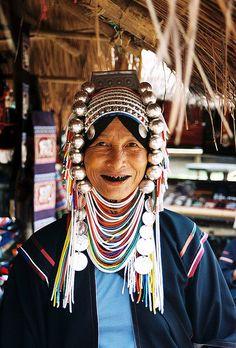 Akha woman  An Akha woman in traditional dress. Check those enamelled teeth! Tha Ton, northern Thailand. September 2006 Adrian Whelan