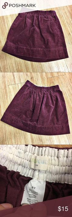 """Crewcuts Burgundy Cord Skirt Corduroy Burgandy 6-7 Crewcuts Burgundy Cord Skirt Corduroy Burgandy 6-7 Factory  Very good used condition.  Elastic in back of waist.  13"""" long.  * Cotton with a hint of stretch. * Sits at waist. * Slant pockets. * Machine wash.  #corduroy #cord #burgundy #burgandy #skirt #preppy #winter #fall #itsfallyall #winteriscoming #crewcuts Crewcuts Bottoms Skirts"""