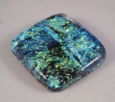 Dichroic glass is glass containing multiple micro-layers of metal oxides which give the glass Dichroic optical properties.