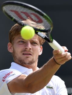 Belgium's David Goffin returns against Switzerland's Stan Wawrinka.  Glyn Kirk, AFP/Getty Images