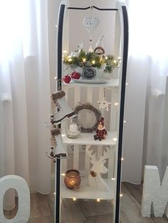 My daughter& sleigh has now become a great decoration. Handmade Home Decor, Diy Home Decor, Christmas Home, Xmas, Lavatory Design, Clear Glass Vases, Tile Design, Wood Table, Ladder Decor