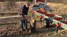 Log deck ramp for portable bandsaw mill