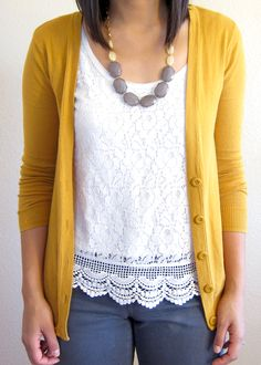 Mustard cardigan, lace top...  I love this combination!  I really need a mustard cardigan!