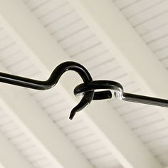 Hand-forged from iron, this hook-and-eye tie-rod replaces the expected wood beam. It's also a functioning turnbuckle.