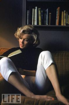 Marilyn Monroe Reads at Home.