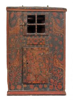 A Scandinavian painted corner cupboard , mid 19th century, with moulded edge above glazed four panel door enclosing cupboard, drawer, and another cupboard, all over decorated with birds and flowering branches 113cm high together with a similar green painted flight of four shelves, late 19th century, 82cm high, 81cm wide, 21cm deep
