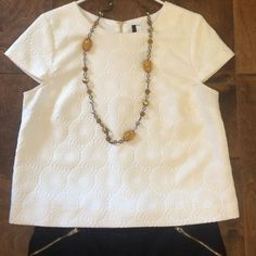KENSIE White Circle Top Beautiful ivory top with circle pattern design by Kensie. Can be paired with a black blazer and worn to work or styled dressy casual as pictured. Only worn a couple times. In excellent condition! Kensie Tops