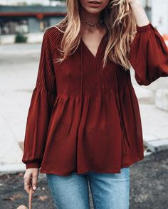 This is something I would wear regularly. I think the cut of the top would really flatter me, I like that shade of red, and to be able to just through it over jean and call it an outfit works great when I am in a hurry.
