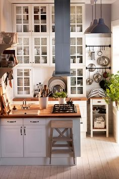 Space Saver - Kitchen Designs - Shabby Chic & Wallpaper Ideas (houseandgarden.co.uk) Love the pot holder towel bars