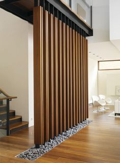 Wood SCREEN wall with stones #wood #architecture | Found on Pinterest via Patricia Gray