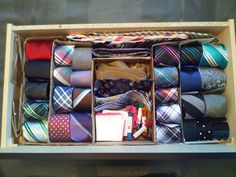A tie organiser by cutting up a shoe box and cardboard box, for when too many ties have been acquired.
