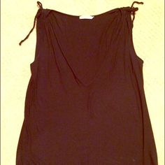 Black sleeveless v-neck Super cute with rushing at shoulders and deep v-neck. Very flattering. Super soft. No holds. Thank you!! Anthropologie Tops Tank Tops
