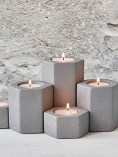 Designed in Sweden, these grey hexagonal tealight holders make a perfect coffee table centrepiece.