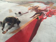 Local artist paints a large propaganda poster to be hung in Chollima Steel Factory, North Korea