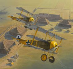 """Fokker triplanes of Jasta 27. The unit's markings included yellow cowlings, wheel covers, struts and rear fuselages. The lead bird belongs to Ltn Rudolf Klimke, whose personal marking was a large anchor. The pilot and serial of the second bird are unknown, but the markings are unique - a large """"V"""" with three small yellow stars. The triplane with the white markings in the bottom left corner is Oblt Hermann Göring, the Staffel commander at the time."""