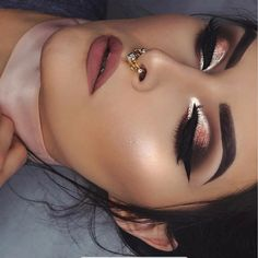 metallic golden and cranberry smokey eye.