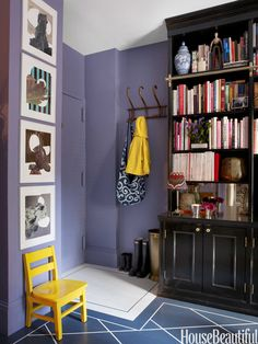 """In David Kaihoi's small New York City apartment, paint signals an entry. """"We designated an entrance simply by painting a small outlined square just inside the front door,"""" Kaihoi says. Walls are Purple Haze by Benjamin Moore.   - HouseBeautiful.com"""