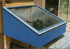 Solar Wall Oven - Solar Cooking.  I like the idea of attaching it to the wall.