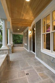 Porch Idea For Side Entrance Looks Fairly Easy To Do . An Elevated Front Porch And A Perfectly Placed Stairway . Solarium Pictures Photos And Decorating Ideas From Patio . Home and Family Porch Tile, Porch Flooring, Stone Flooring, House With Porch, House Front, Front Deck, Stone Front House, Front Porch Columns, Front Porch Design