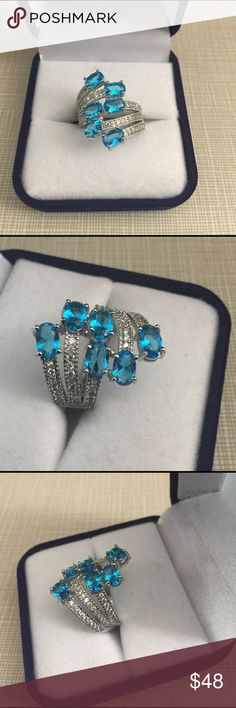 Hot buy Swiss blue Quartz white Cz ring Gorgeous faceted stones Swiss Quartz ring size 6'1/2 with cz's width is 23x23mm gemstone size is 6x4mm very attractive stamped 925 inlay nwot Jewelry Rings