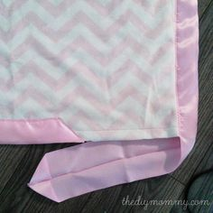 How to sew the softest DIY baby blanket with two layers of minky fabric and satin binding