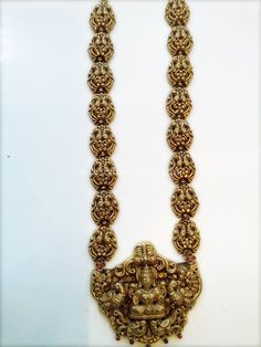 Gold Antique Long Haram With Temple Pendant ~ South India Jewels Gold Temple Jewellery, Indian Wedding Jewelry, Bridal Jewelry, Gold Jewelry, India Jewelry, Gold Bangles Design, Gold Earrings Designs, Gold Jewellery Design, Antique Jewellery Designs