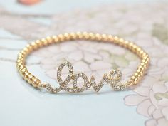 Fashion mix - Crystal Sideways Gold Love Bracelet by… on We Heart It - http://weheartit.com/entry/55692227/via/silviairoth
