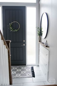 DIY Split Level Entry Makeover- I LOVE this entry. The oversize door, scandi inf… DIY Split Level Entry Makeover- I LOVE this entry. The oversize door, scandi influence and that shoe storage! Split Entry Remodel, Home, Basement Remodeling, Home Remodeling, Foyer Decorating, Exterior Entryway Ideas, Home Renovation, Exterior Remodel, Split Foyer