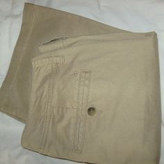 American Eagle khakis American Eagle Outfitters. They have some stretch in them, size 12 long. Perfect condition, I just don't wear khakis anymore! American Eagle Outfitters Pants Boot Cut & Flare