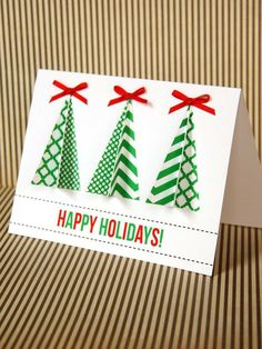 handmade Christmas card ... triangle trees cut with Cricut ... like the various green patterned papers and the folded up layers ... fun card