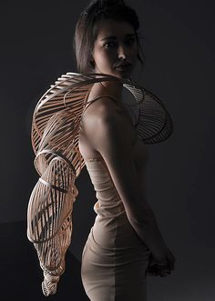Stephanie Bila, wearable art, wood- I like the design of this piece as well as the way it fits on the woman