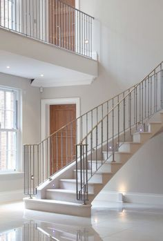 22. Steel supported moleanos stone cantilever stair with stainless steel balustrade and brass handrail – Hertfordshire