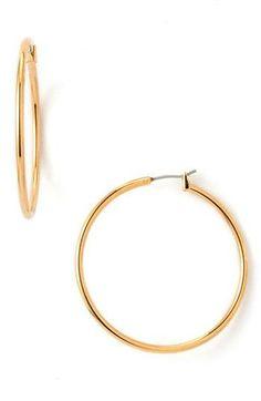 Megan Hilty: Nordstrom Classic Hoop Earrings in Gold   $26