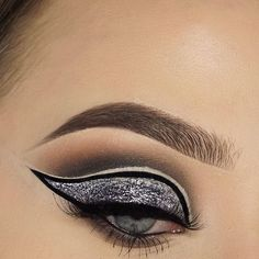 "New Years look numberrr 1 🙌 ✨✨✨ @sigmabeauty black line ace liquid liner and some brushes used to achieve this look. Use code ""EMALII"" for 10% off your order! @anastasiabeverlyhills dip brow in ebony and concealer to clean up brows @luxylash KEEP IT 100 lashes (use code 'EMALII' for $$$ off!) @nyxcosmetics glitter in gunmetal  @thebalm_cosmetics mad lash mascara  @makeupgeekcosmetics shadow in corrupt, vanilla bean, latte and cocoa bear  @morphebrushes some brushes used ✨✨✨#skincare…"