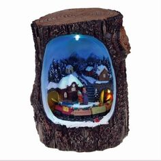 Lightahead Christmas Multi Color LED Lighted Rotating scene in a Log, Musical with 8 melodies Tabletop Centerpieces (Train Ride)