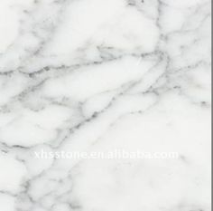 "Carrara White Granite (kitchen countertops if you want to go with the ""marble"" look)"