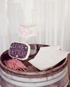 Rethink the traditional guest book. Friends and loved ones at Jenn and Cody's nuptials passed their well-wishes to the newlyweds in the form of Mad Libs-style love letters.