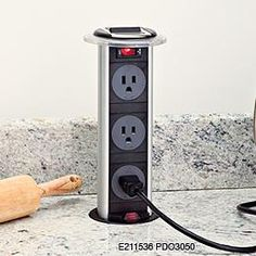 hole in granite for electrical outlet | electrical receptacle granite island quartz island