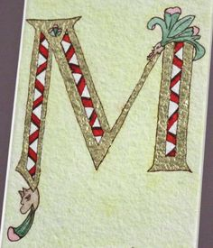 Illuminated letter M on watercolor